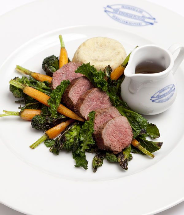 Emily Watkins' lamb loin with pudding recipe celebrates the flavours and ingredients of spring, featuring seasonal purple sprouting broccoli alongside lamb and carrots. The suet pudding adds further appeal to this delicious dish.