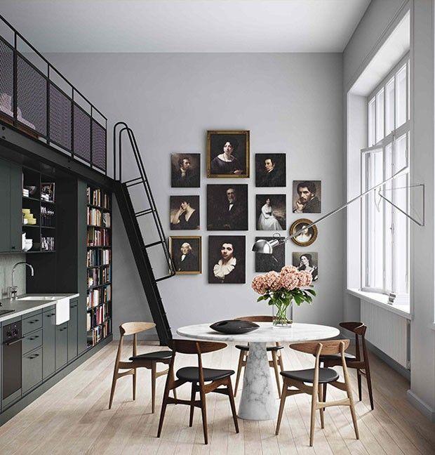 Cozinha com inspiração nórdica, mesa de mármore, piso de madeira e quadros na parede