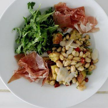 THE PATIO SALAD - white beans, celery, carrot, and breadcrumbs tossed in pesto with arugula and proscuitto