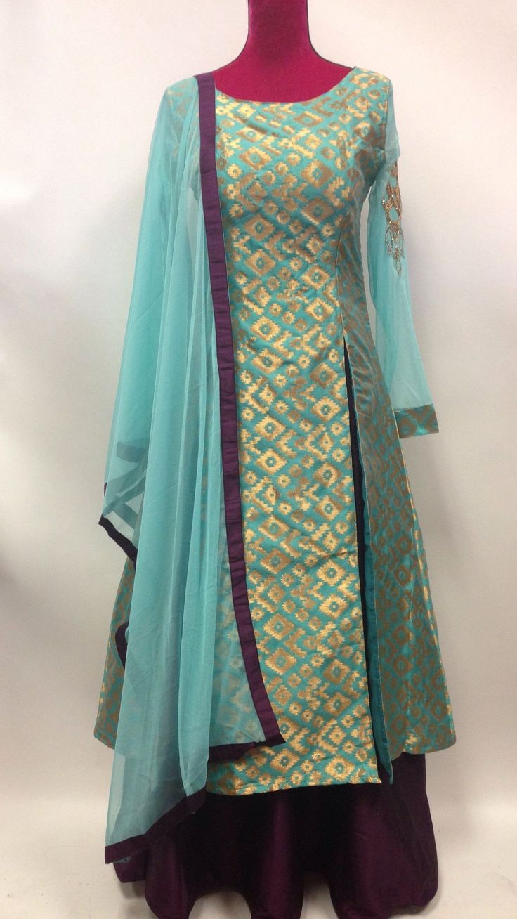 Purple and blue brocade lehenga suit is made with glitzy foliage patterns…