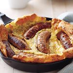 Toad in the Hole. I usually use 2 packages of either bratwurst or sweet italian sausages (5-6 sausages per package), and I serve with sautéed onions and mushrooms in brown gravy. I also will often top with some mozzarella or monterey jack cheese before serving!