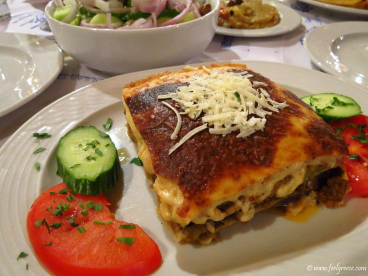 Moussaka - traditional baked dish with potatoes and aubergines, topped with bechamel and eggs