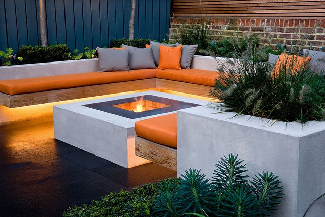 Chill Out Garden | Contemporary seating area with linear underlighting and firepit | Charlotte Rowe Garden Design