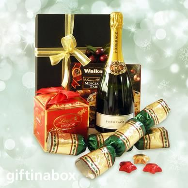 A festive hamper for cheers to all! Beautifully wrapped in an elegant black box with gold ribbons and wrapping paper  Bottle of Pongracz champagne 200g Lindt Lindor Christmas chocolate box 360g Christmas mince pies 2 festive Christmas crackers