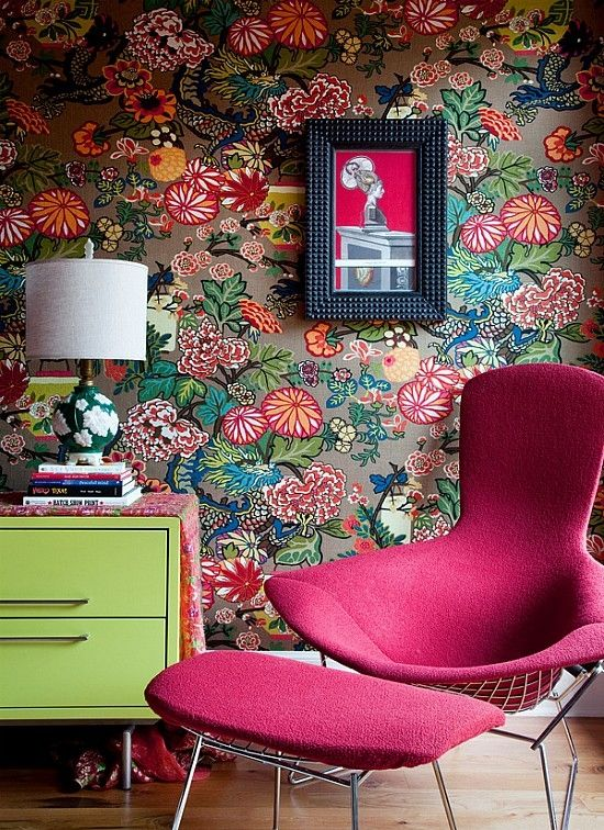 A bold and contemporary floral wallpaper is accented with this fun chair, ottoman and side table which reflect the colours of the wallpaper.
