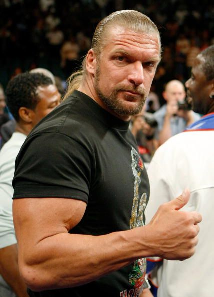 WWE wrestler Triple H poses in the ring after Floyd Mayweather Jr defeated Juan Manuel Marquez in a unanimous decision at the MGM Grand Garden Arena...
