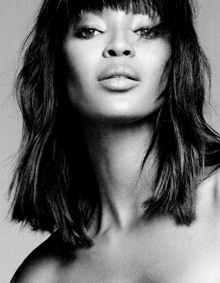 Naomi Campbell. its a wig or weave i know, but i would love to see brown girls style their hair like this and not so server and heavy laden with product.