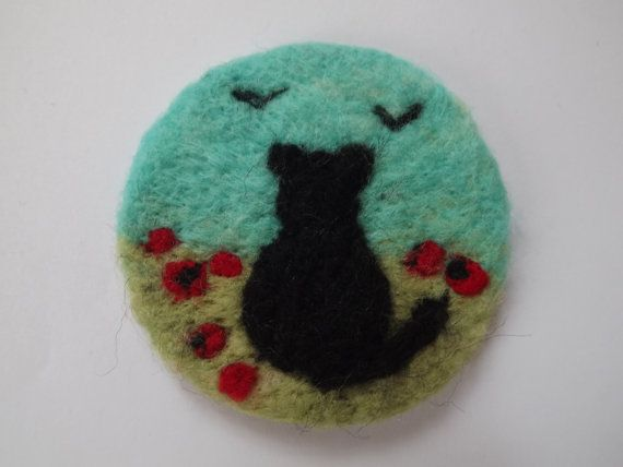 Needle felted brooch badge of cat in a field of by fantasytextiles
