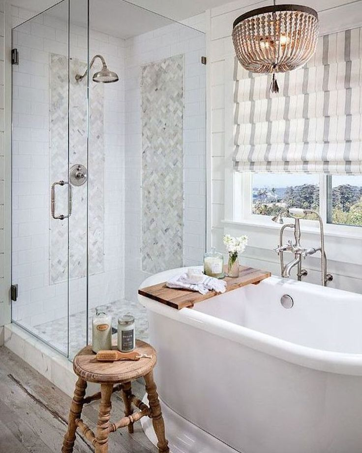Would love to do something similar in our master bath at front range house: modernize shower stall, put in smaller more functional tub with cute chandelier above...