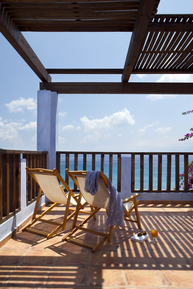 Enjoy the view from the seafront veranda of Candia Park Village in Crete.