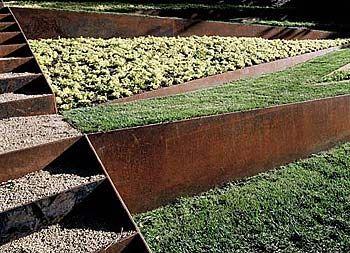Raw steel retaining walls - Andrea Cochran