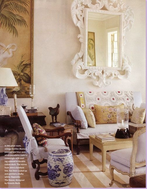 Striped dhurri rug in West Indies beach house ... white slip covered furniture with dark woods and a big tropical painting. Blue and white ceramics and lots of layering of fun stuff. The Remy would fit into this kind of approach.