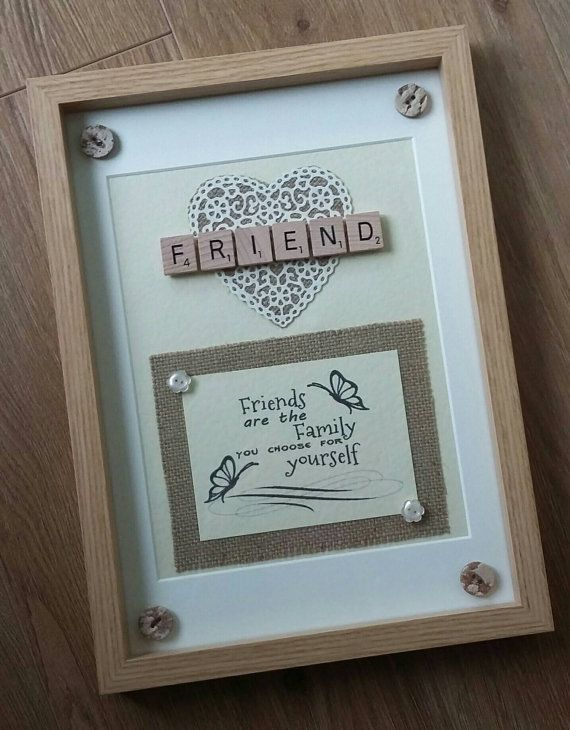 YOU ARE BUYING AN 10 x 12 SCRABBLE ART FRAME IN LIGHT WOOD COLOUR HANDMADE TO ORDER THE BACKGROUND IS CREAM LINEN CARD AND A HESSIAN BACKED FILAGREE HEART IS SET BEHIND THE WORD FRIEND OR A NAME OF YOUR CHOICE UP TO 9 TILES ACROSS A FRIENSHIP QUOTE IS SET ON A HESSIAN BACKGROUND RUSTIC BUTTONS (DESIGNS MAY DIFFER FROM PHOTO) AT THE CORNERS AND TWO FLOWER SHAPE BUTTONS FINISH THE FRAME. ALL MATERIALS ARE PLACED UNDER GLASS, THE TILES AND BUTTONS ON THE TOP OF THE GLASS I ALWAYS SEND A ...