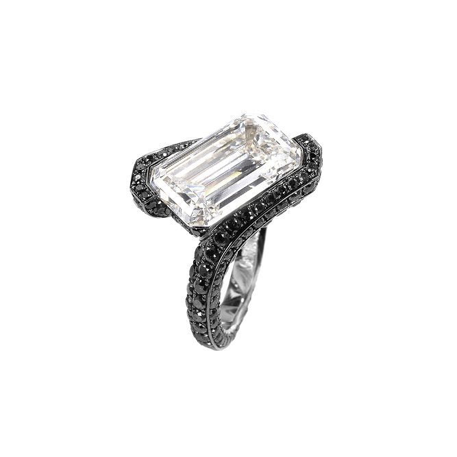 Engagement Rings –  de Grisogono emerald cut white diamond surrounded by black diamonds, price upon request