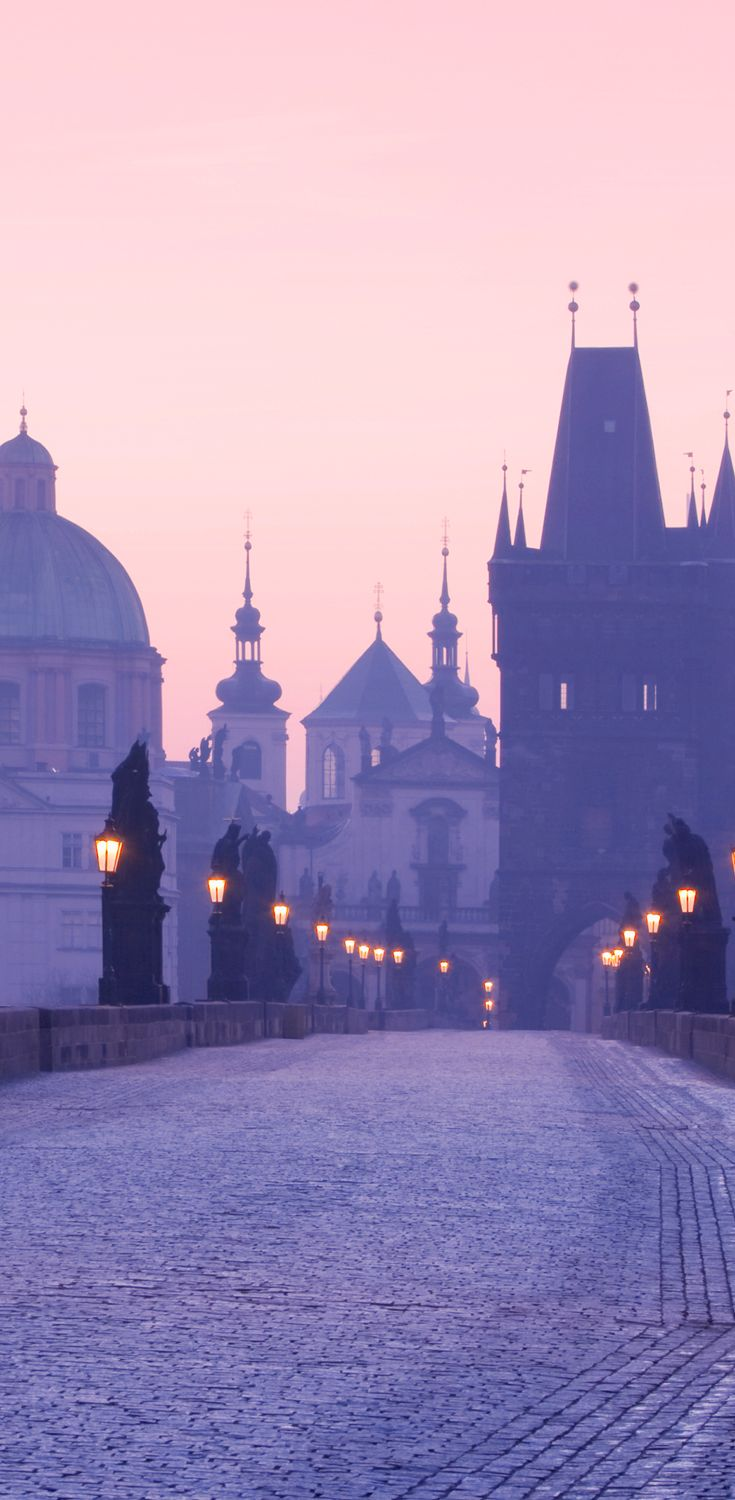 Breathtaking purple skies of Prague. This is the Charles bridge heading over to Old Town- cool city!
