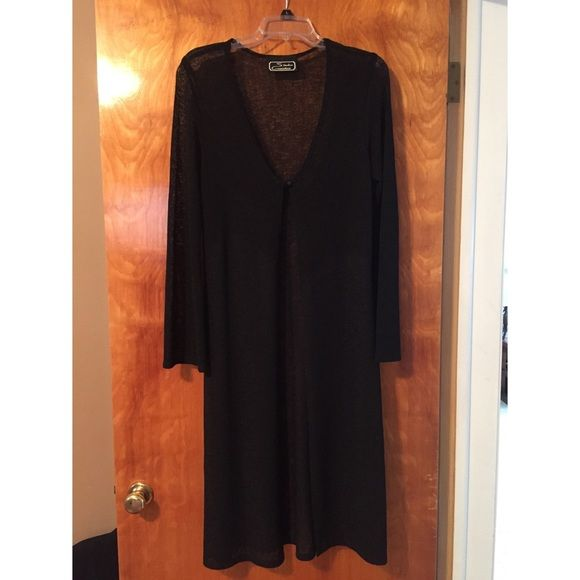 Studio Connection Long Black Cardigan Sweater Studio Connection Long Black Cardigan Sweater. Beautiful to wear over that little black dress, with a great cami and jeans or a skirt! Size Medium. 16 inches shoulder to shoulder - 44 inches neckline to hem. Studio Connection Sweaters Cardigans