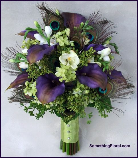 Realistic, artificial bridal bouquet of purple calla lilies, green lilac, white freesia, and genuine peacock feathers. Stem wrap finished in spring green satin and pearl accents. By Something Spectacular/Something Floral, Warren, MI.