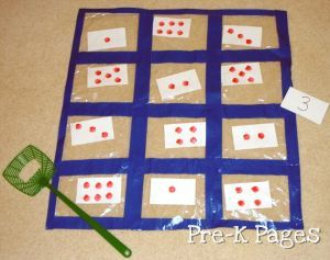 ziploc quilt number game. Love this idea for learning subitizing, numeral recognition, sight words... Could just use tape strait onto the floor too.