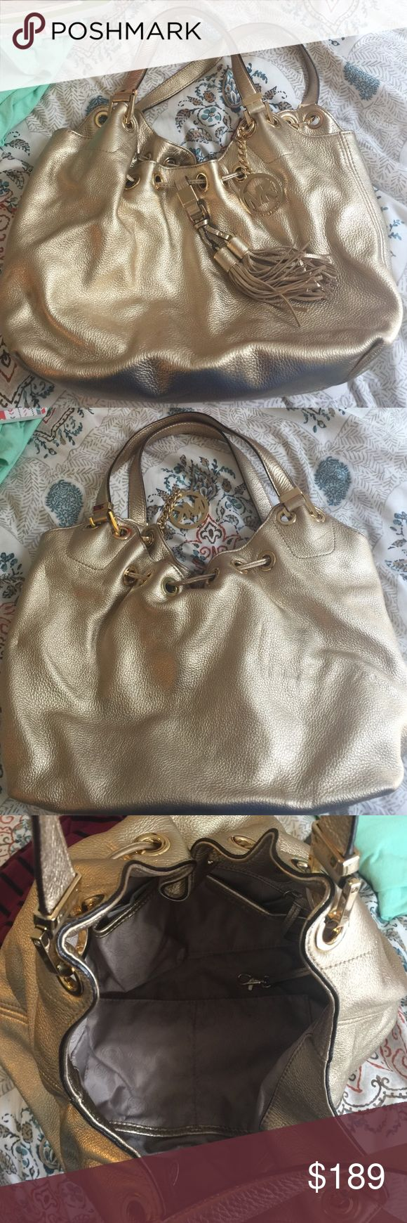Gold Michael Kors Purse 2014 Used but in good shape, clean with original tags and some original paper in the pockets Michael Kors Bags Shoulder Bags