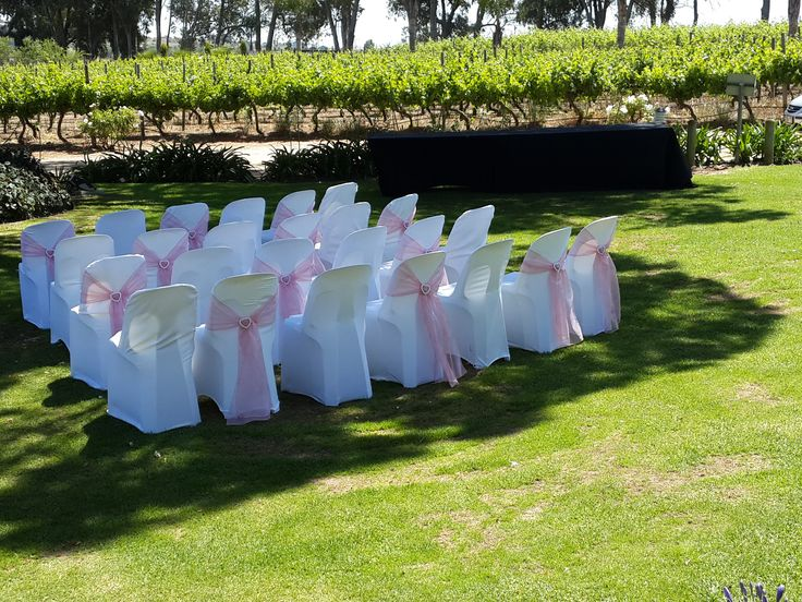 white chair covers with pink tie backs and diamante heart buckle