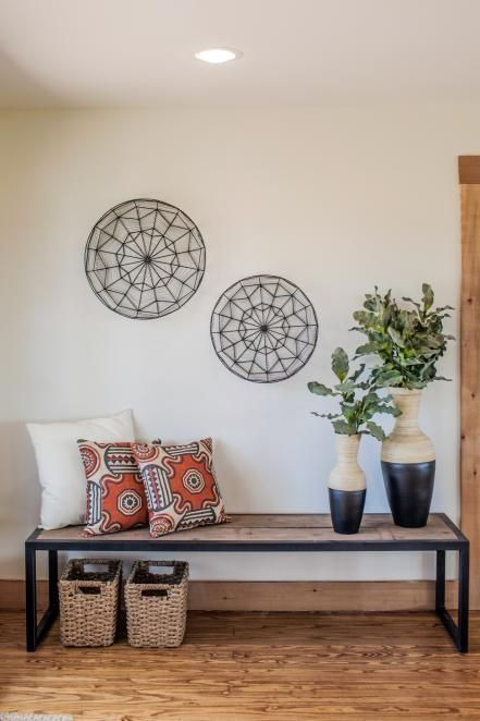 A bench, storage containers and design accents were used to fill an empty area of the Zan family's newly remodeled home while also creating more seating when they entertain large groups, as seen on Fixer Upper.
