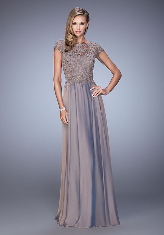 Charming chiffon gown with intricate lace bodice and cap sleeves. Back zipper closure. Evening Collection Size Chart B.