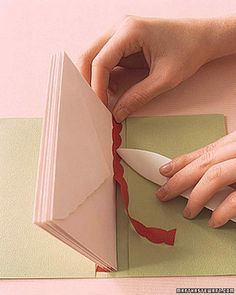 A paperback Kwanza book has seven pages, one for each day of celebration. The holiday's daily themes are reflected in the passages enclosed in each envelope.In the gardening book, each envelope holds seeds, with tips and instructions for planting.Note: Bind envelopes as in step 1 of Envelope Books: Cloth Binding How-To.Return to Envelope Books.