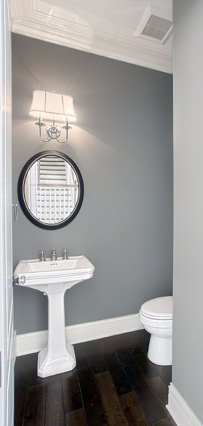 Simple yet beautiful powder room with a pedestal sink and - Powder room sink ideas ...