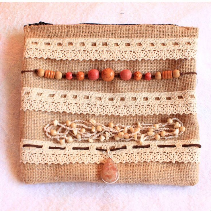 New in-store! Burlap, Hessian clutch bags, embellished boho shabby chic style, beads, shells, vintage white lace & sunstone gemstone pendant. Zippered opening & fabric lining inside this eco friendly jute handbag is cute & made from recycled materials!