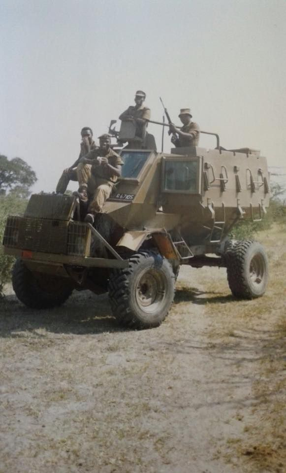 202 Bn Buffel and soldiers. I apologize about the poor picture quality and I will try to get proper scans or better pictures. Taken by 2Lt Ronnie Skolnic in 1987.