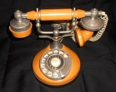 Vintage ITT Own-A-Phone Princess French Style Rotary Dial, orange telephone  Repinned by www.silver-and-grey.com