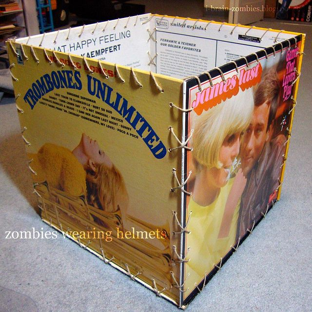 not sure I could handle destroying any of my album covers, but if I came across some record covers at a garage sale or thrift store, then I'd totally make some of these. I'd reenforce it somehow and maybe add a handle.