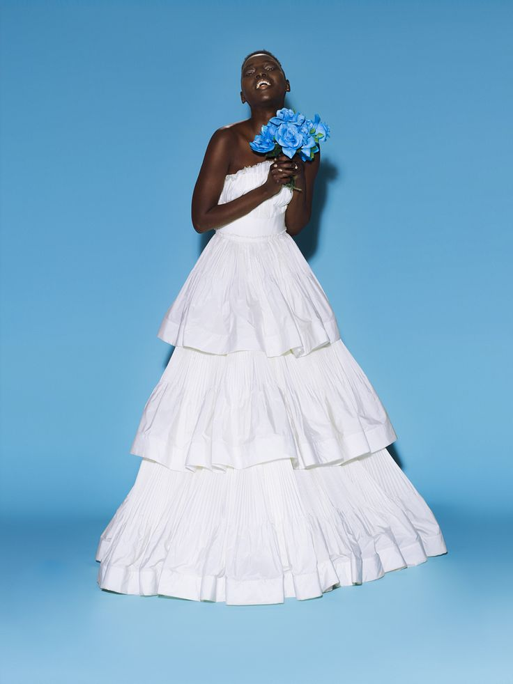 Newlywed Mari Malek is a DJ/producer and an activist for South Sudan. She\'s also beautiful and happy, much like this dress.Mari Malek in LanvinLanvin white strapless long dress with layered ruffles on the bottom and a bow on the waist, price upon request Lanvin, NYC, 646.439.0380