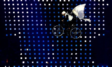 A performer on a bike flies in the air  during the Opening Ceremony of the London 2012 Olympic Games
