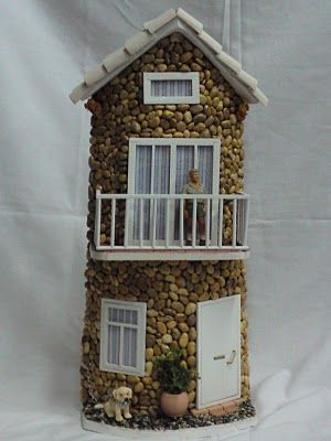 I will try to recreate this, on one of the wooden houses I have purchased. I have similar rocks from the dollar store. This will be so cool.....