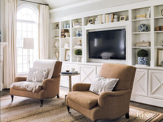 Living room bookcase wall. Lillian August club chairs and a cocktail table by Bliss Studio sit in front of a custom bookcase wall. #Bookcase #wall #Livingroom Beth Gularson. Helen Norman Photography.