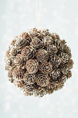 pinecone ball - At the top I added a   ribbon loop then tied a ribbon bow to it. Use less delicate pinecones and hot   glue them to styrofoam ball. In between you can add juniper berries, rosehips,   all spice berries. I have sold a ton of these! Wonderful. Mine were also scented   by sprinkling scented oils on them.