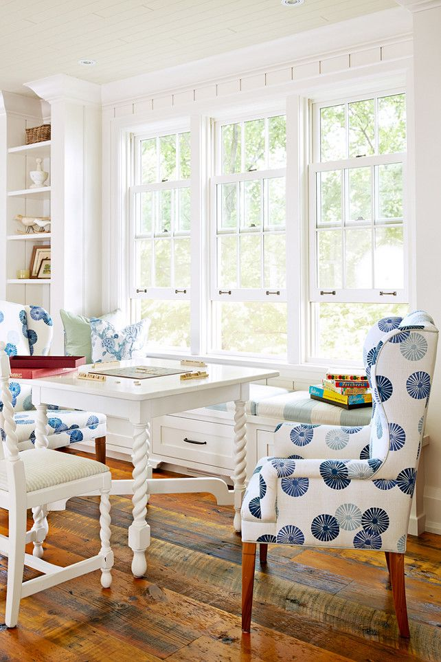 Breakfast Room Banquette and Chairs designed by Sarah Richardson. Breakfast room. Classic wingback chairs get an upgrade with a fresh print from Lee Jofa. Paired with a white game table, they make the house's library a cozy gathering spot. Designed by Sarah Richardson.