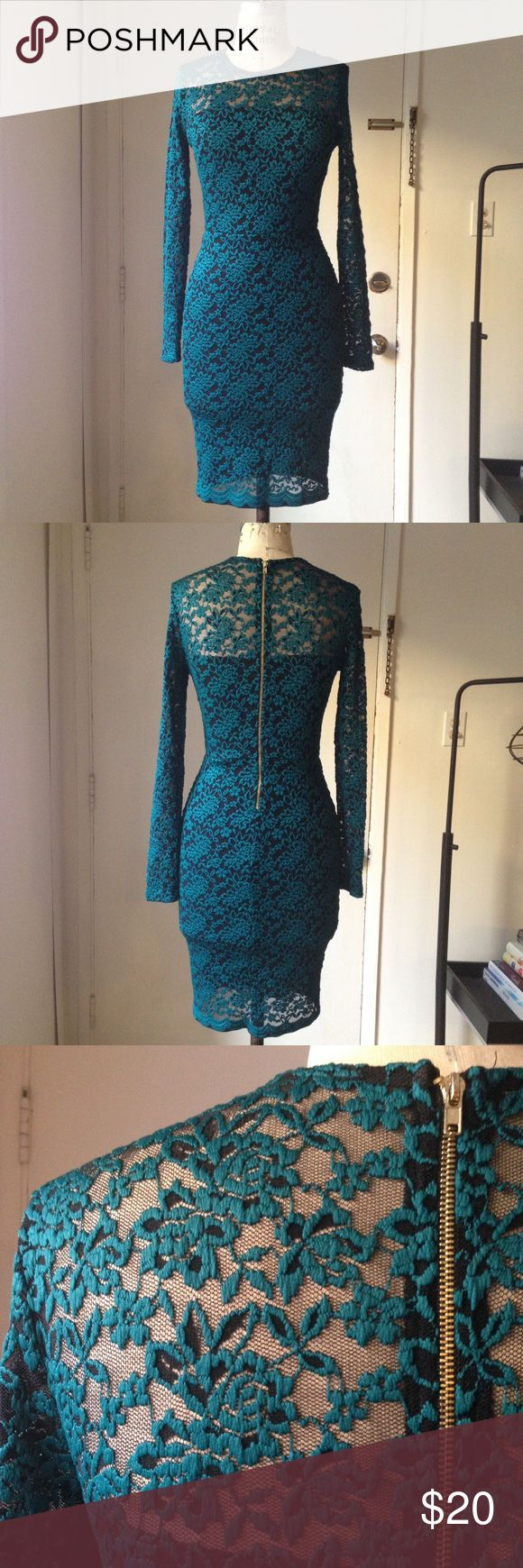 Blue teal lace black dress underlay S Awesome lace dress with black underlay. Hits below the knee, body con style with back gold tone zipper. Dresses