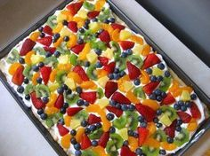 "Crust 1 package Pillsbury sugar cookie dough.  Roll out dough and bake on bottom of pan. Let it cool completely.  Topping 8 oz. cream cheese, softened ½ cup sugar 1 tsp. vanilla extract 1 container Cool Whip, thawed Fresh fruit  For topping, blend cream cheese, sugar, and vanilla. Fold in Cool Whip. Spread this cream cheese mixture over crust.  Use assorted fresh fruit for the pizza ""toppings."" Arrange fruit over cream cheese mixture. Cut and serve. Store leftovers in refrigerator."