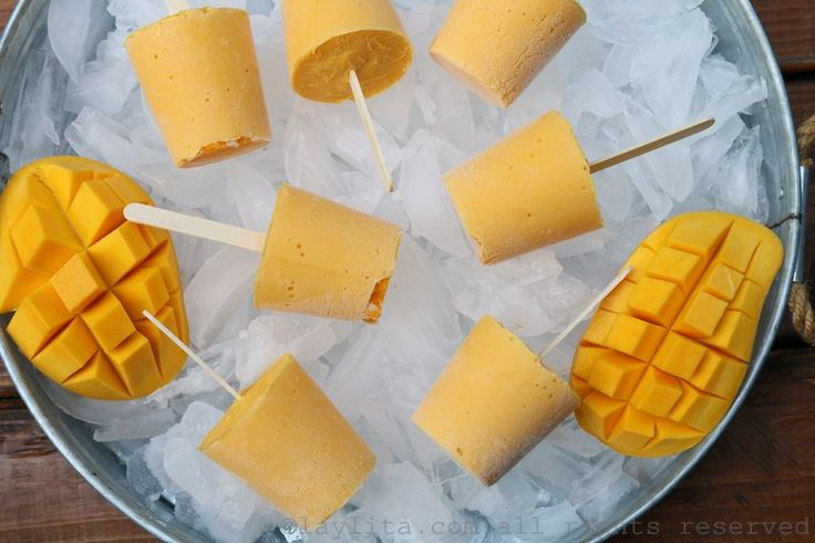 Quick and easy recipe for creamy mango yogurt popsicles made with yogurt, ripe mangoes, and honey.