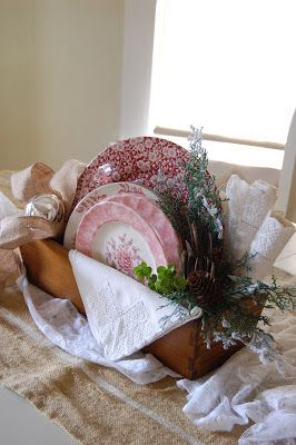 A little frosted greenery turns an everyday vignette into...Christmas!  Wooden box with vintage china