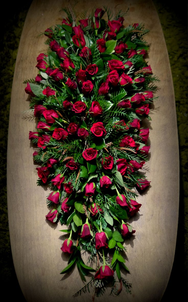 Gorgeous red rose funeral casket spray