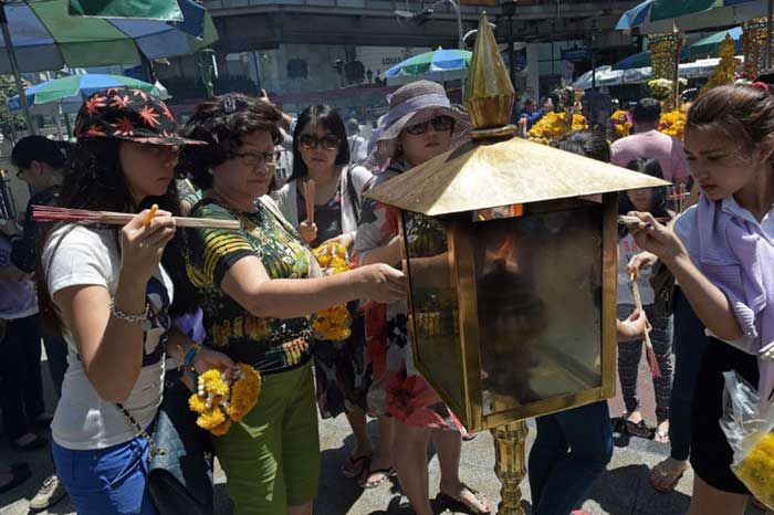 visitors-at-the-reopened-erawan-shrine-in-bangkok-on-thursday-lotuses-orchids-and-other-flowers-had-been-left-on-a-fence-at-the-shrine-compound-in-memory-of-those-killed.