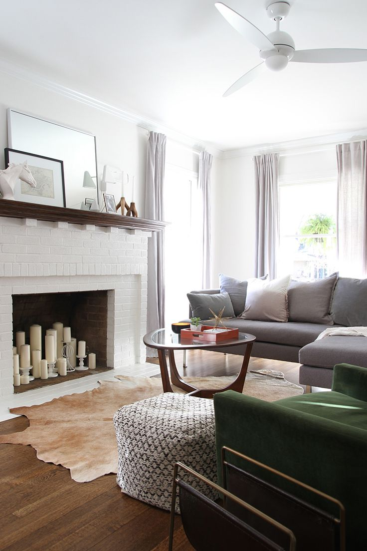 Let's talk about tricky spaces. There's always one room in a house that proves to be a challenge. My living room happens to be one of these odd design dilemmas. Here's the issues …