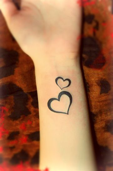 One big and one small heart tattoo designs on the wrist