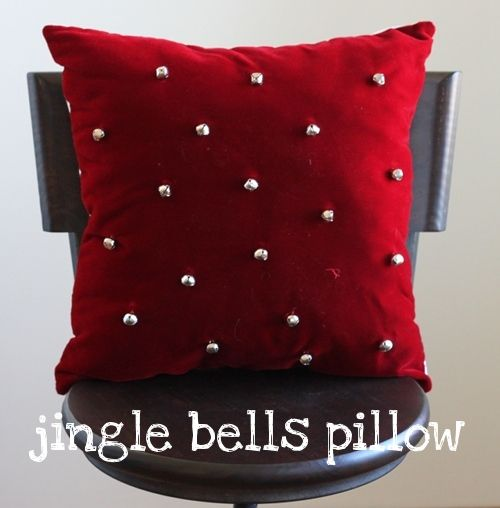 Jingle bell pillow  So cute - She has some other ideas for dressing of throw pillows for the Christmas holidays. The neat thing is the ideas can be used for different seasons of the year. And they are all really easy - store bought pillows and you apply the decorations. I love it!