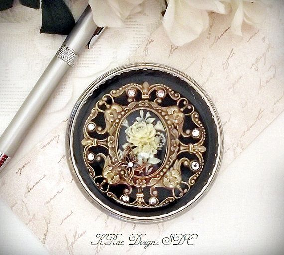 DOME GLASS PAPERWEIGHT-featuring a black and ivory rose cameo, antique filigree and Swarovski crystals by KRae Designs for Simply Divine Creations