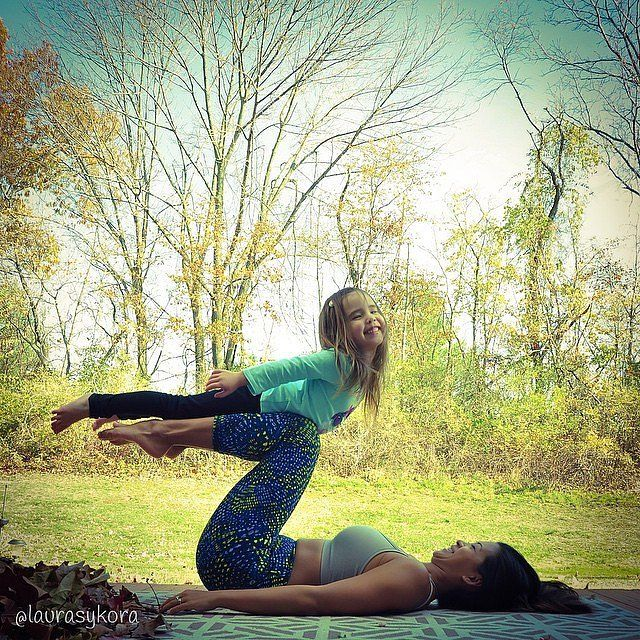 Like Mother, Like Daughter: This Pair of Yogis Is Too Cute For Words: When it comes to mother-daughter bonding, most duos have Gilmore Girls marathons or go out to lunch together — but that's not the case with yoga instructor Laura Kasperzak and her little girl.