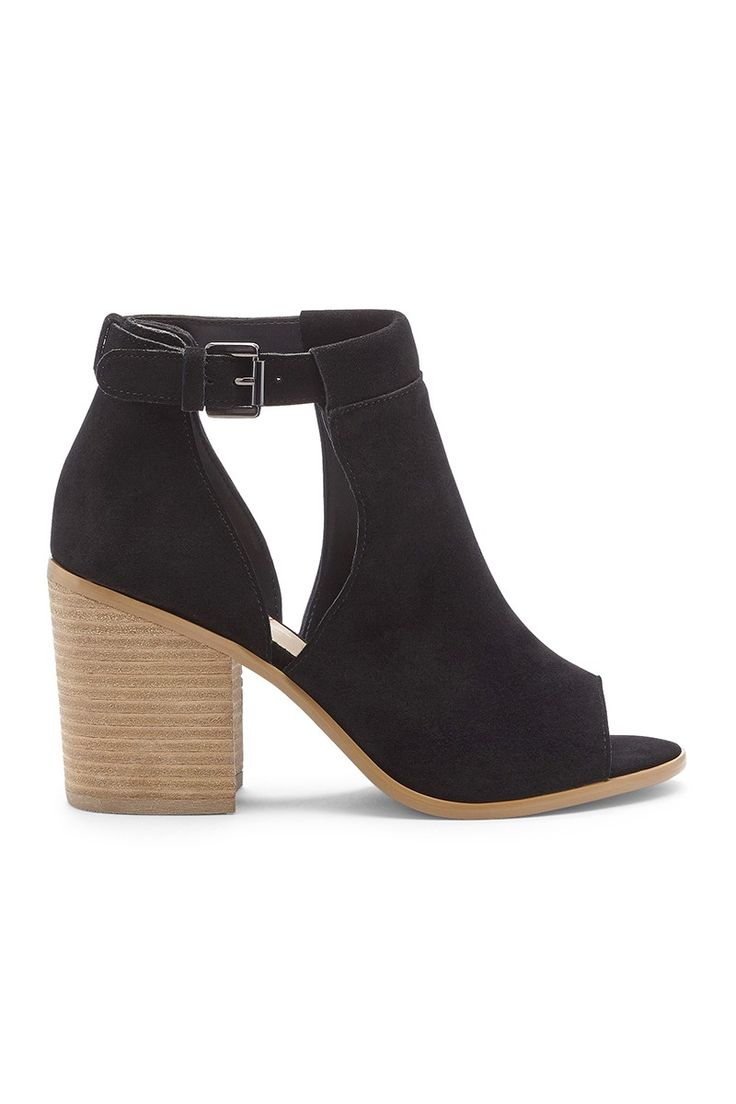 Black suede cutout block heel booties.